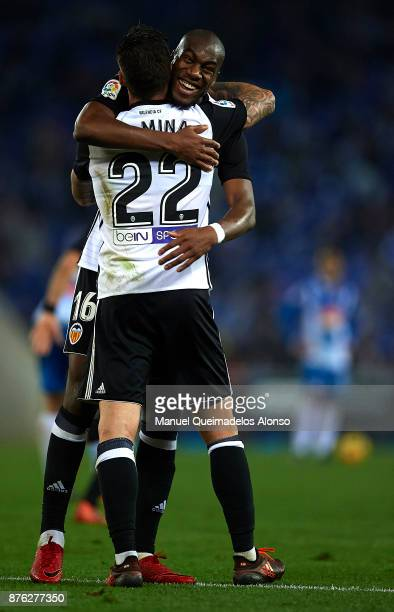 Santi Mina of Valencia celebrates scoring his team's second goal with his teammate Geoffrey Kondogbia during the La Liga match between Espanyol and...