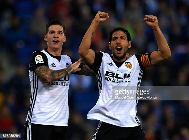 Santi Mina of Valencia celebrates with his teammate Daniel Parejo during the La Liga match between Espanyol and Valencia at CornellaEl Prat stadium...