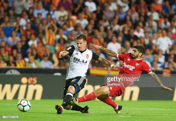 Santi Mina of Valencia CF and Ever Banega of Sevilla FC in action during the La Liga match between Valencia CF and Sevilla FC at Estadio Mestalla on...