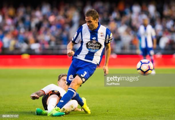 Santi Mina of Valencia CF and Fernando Navarro of Deportivo de la Corua during their La Liga match between Valencia CF and Deportivo de la Corua at...