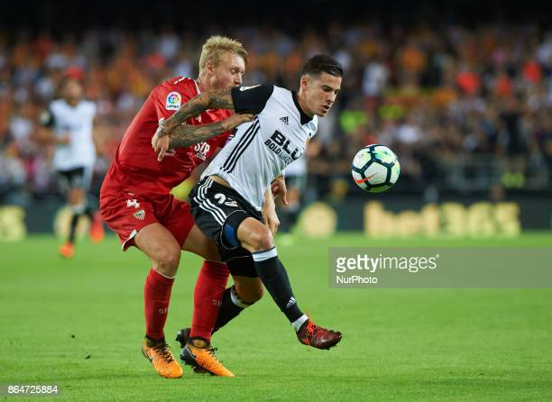 Santi Mina of Valencia CF and Simon Kjaer of Sevilla FC in action during the La Liga match between Valencia CF and Sevilla FC at Estadio Mestalla on...