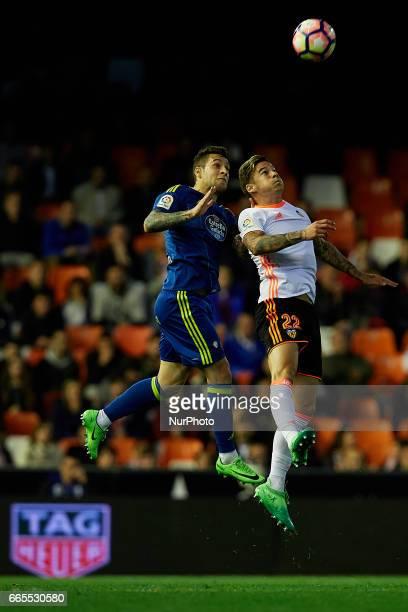 Santi Mina of Valencia CF heads the ball next to Hugo Mallo of Real Club Celta de Vigo during the La Liga match between Valencia CF and Real Club...