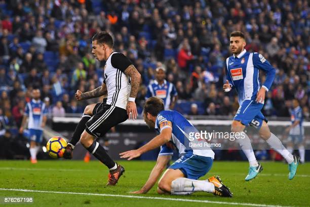 Santi Mina of Valencia CF scores his team's second goal during the La Liga match between Espanyol and Valencia at Cornella El Prat stadium on...
