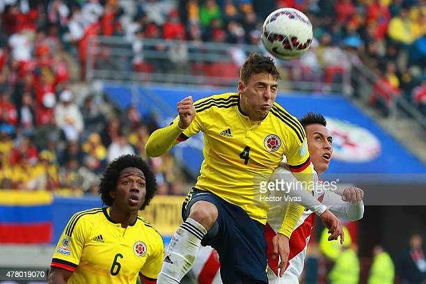 Santiago Arias of Colombia goes for a header during the 2015 Copa America Chile Group C match between Colombia and Peru at Municipal Bicentenario...