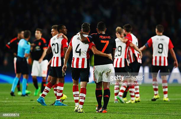 Santiago Arias of PSV Eindhoven and Memphis Depay of Manchester United embrace after the UEFA Champions League Group B match between PSV Eindhoven...