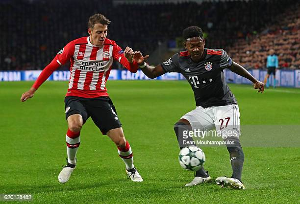 Santiago Arias of PSV Eindhoven puts pressure on David Alaba of Bayern Muenchen during the UEFA Champions League Group D match between PSV Eindhoven...
