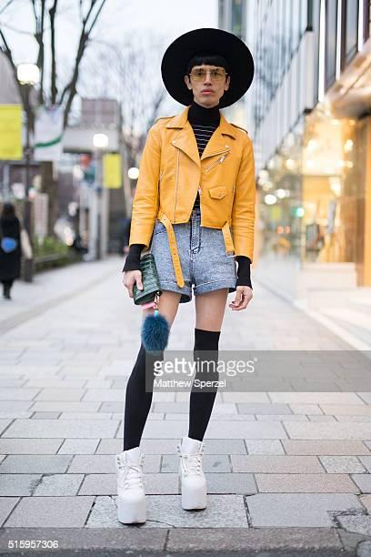 Santiago Artemis is seen on the street in Harajuku during Tokyo Fashion Week wearing a Made in Chola hat Zara jacket vintage pullover Wego shorts Ryu...