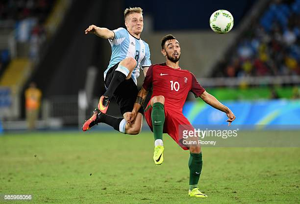 Santiago Ascacibar of Argentina and Fernandes Bruno of Portugal compete for the ball during the Men's Group D first round match between Portugal and...