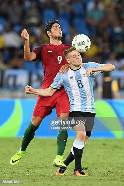 Santiago Ascacibar of Argentina and Paciencia Goncalo of Portugal compete for the ball during the Men's Group D first round match between Portugal...
