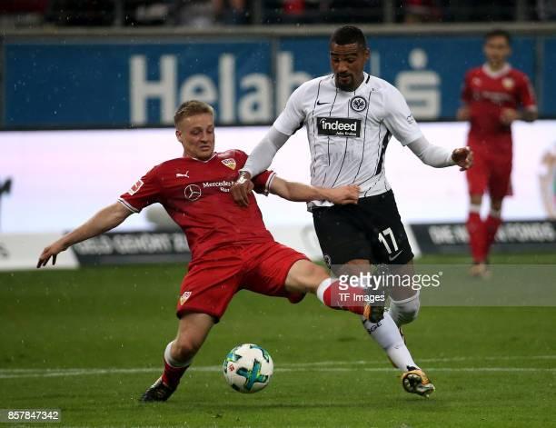 Santiago Ascacibar of Stuttgart and KevinPrince Boateng of Frankfurt battle for the ball during the Bundesliga match between Eintracht Frankfurt and...