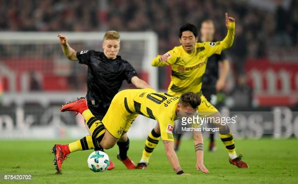 Santiago Ascacibar of Stuttgart challenges Maximilian Philipp of Dortmund and Shinji Kagawa of Dortmund during the Bundesliga match between VfB...