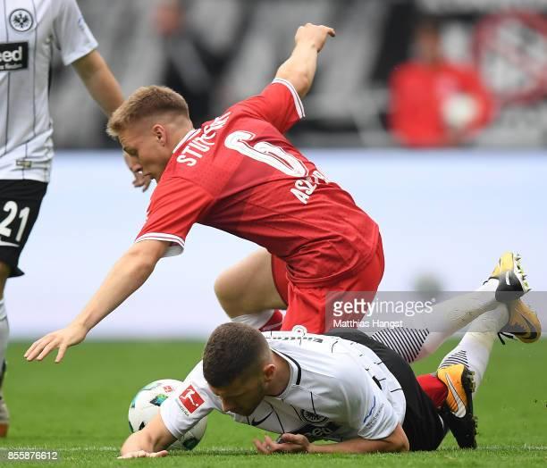 Santiago Ascacibar of Stuttgart fights for the ball with Ante Rebic of Frankfurt during the Bundesliga match between Eintracht Frankfurt and VfB...