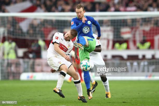 Santiago Ascacibar of Stuttgart fights for the ball with Maximilian Arnold of Wolfsburg during the Bundesliga match between VfB Stuttgart and VfL...