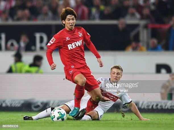 Santiago Ascacibar of VfB Stuttgart tackles Yuya Osako of 1FC Koeln during the Bundesliga match between VfB Stuttgart and 1 FC Koeln at MercedesBenz...