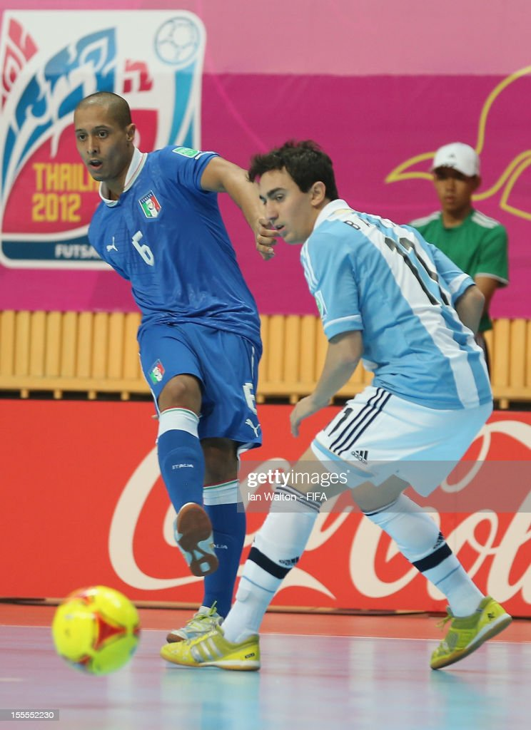 Santiago Basile of Argentina tries to tackle Humberto Honorio of Italy during the FIFA Futsal World Cup Thailand 2012, Group D match between Argentina and Italy at Nimibutr Stadium on November 5, 2012 in Bangkok, Thailand.