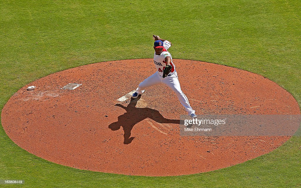 <a gi-track='captionPersonalityLinkClicked' href=/galleries/search?phrase=Santiago+Casilla&family=editorial&specificpeople=682637 ng-click='$event.stopPropagation()'>Santiago Casilla</a> #44 of the Dominican Republic pitches during a World Baseball Classic second round game against Puerto Rico at Marlins Park on March 16, 2013 in Miami, Florida.