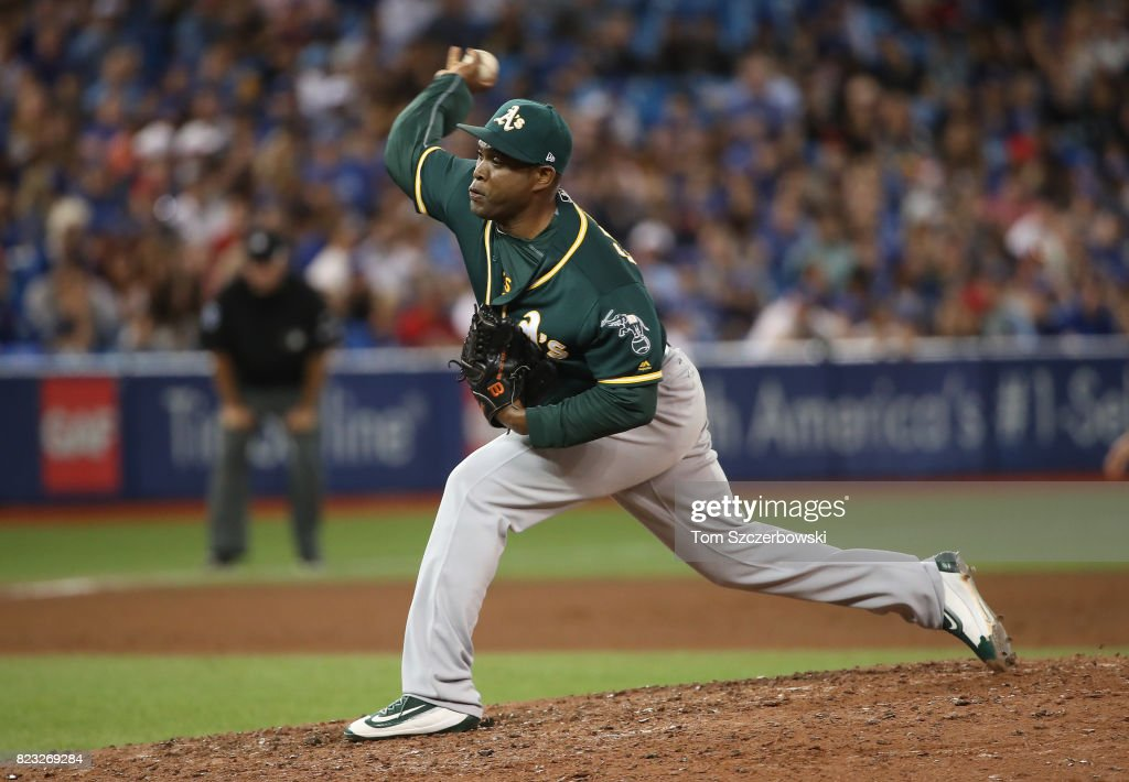 Santiago Casilla #46 of the Oakland Athletics delivers a pitch in the ninth inning during MLB game action against the Toronto Blue Jays at Rogers Centre on July 26, 2017 in Toronto, Canada.