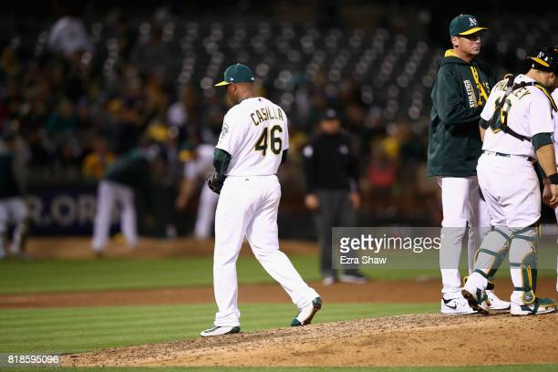 Santiago Casilla of the Oakland Athletics is taken out of the game my manager Bob Melvin after giving up two runs in the ninth inning against the...