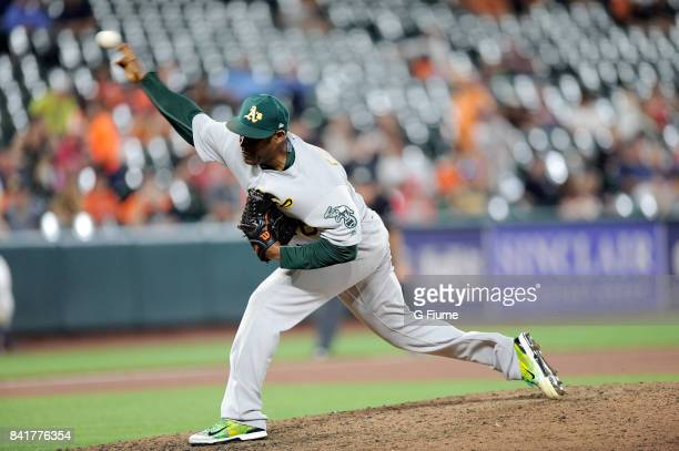 Santiago Casilla of the Oakland Athletics pitches against the Baltimore Orioles at Oriole Park at Camden Yards on August 21 2017 in Baltimore Maryland