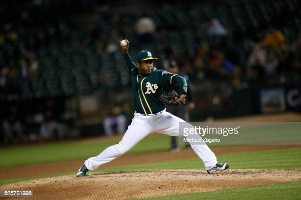 Santiago Casilla of the Oakland Athletics pitches during the game against the Cleveland Indians at the Oakland Alameda Coliseum on July 14 2017 in...