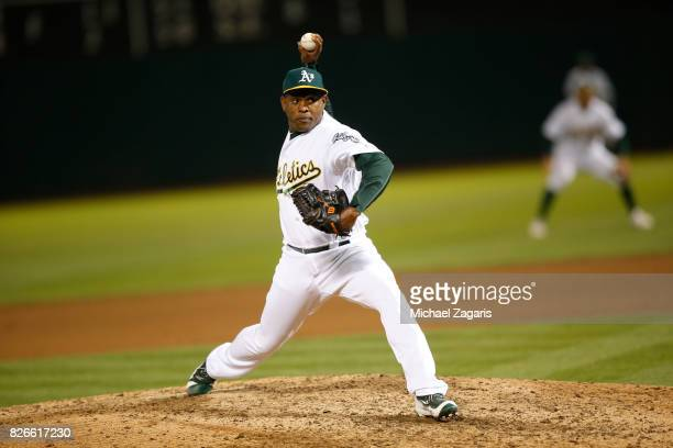 Santiago Casilla of the Oakland Athletics pitches during the game against the Tampa Bay Rays at the Oakland Alameda Coliseum on July 18 2017 in...