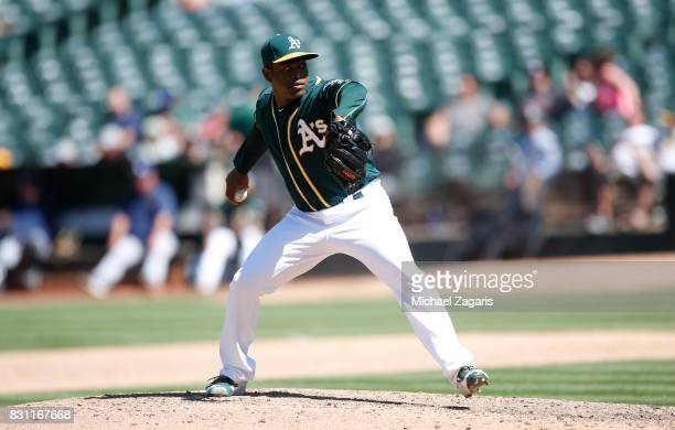 Santiago Casilla of the Oakland Athletics pitches during the game against the Tampa Bay Rays at the Oakland Alameda Coliseum on July 19 2017 in...