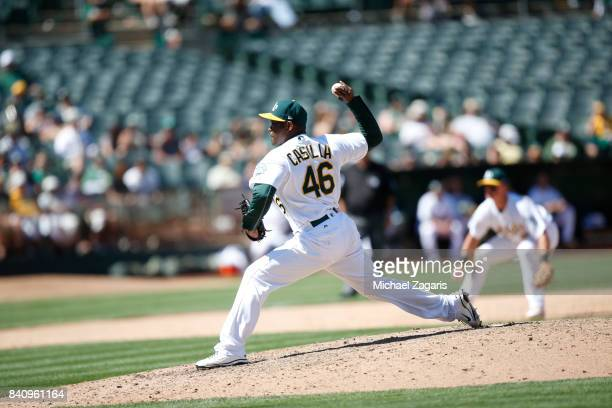 Santiago Casilla of the Oakland Athletics pitches during the game against the Minnesota Twins at the Oakland Alameda Coliseum on July 30 2017 in...