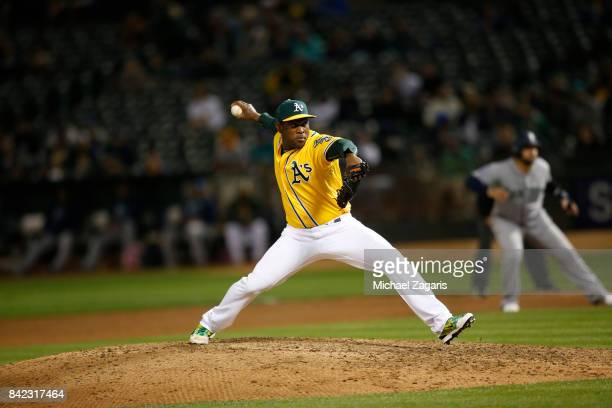 Santiago Casilla of the Oakland Athletics pitches during the game against the Seattle Mariners at the Oakland Alameda Coliseum on August 8 2017 in...
