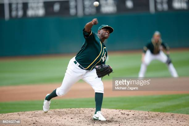 Santiago Casilla of the Oakland Athletics pitches during the game against the Seattle Mariners at the Oakland Alameda Coliseum on August 9 2017 in...