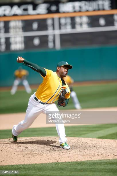 Santiago Casilla of the Oakland Athletics pitches during the game against the Baltimore Orioles at the Oakland Alameda Coliseum on August 13 2017 in...
