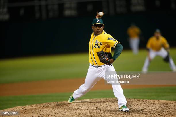 Santiago Casilla of the Oakland Athletics pitches during the game against the Kansas City Royals at the Oakland Alameda Coliseum on August 15 2017 in...