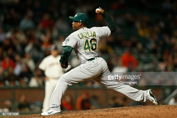 Santiago Casilla of the Oakland Athletics pitches in the ninth inning against the San Francisco Giants during an interleague game at ATT Park on...