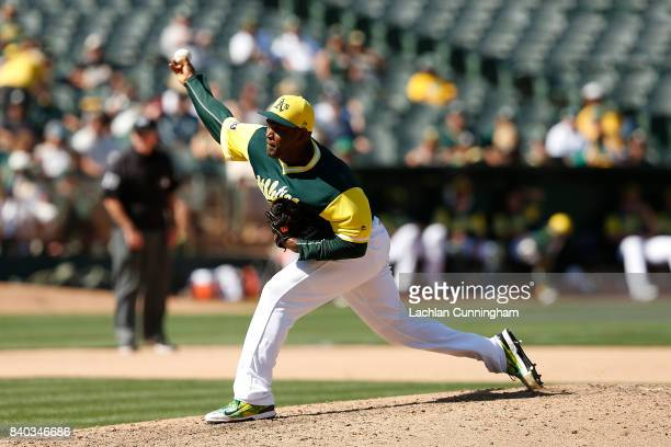 Santiago Casilla of the Oakland Athletics pitches in the seventh inning against the Texas Rangers at Oakland Alameda Coliseum on August 26 2017 in...