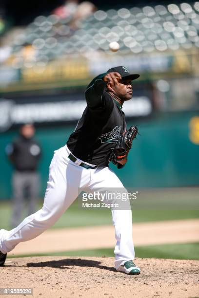 Santiago Casilla of the Oakland Athletics pitches the game against the Atlanta Braves at the Oakland Alameda Coliseum on July 1 2017 in Oakland...