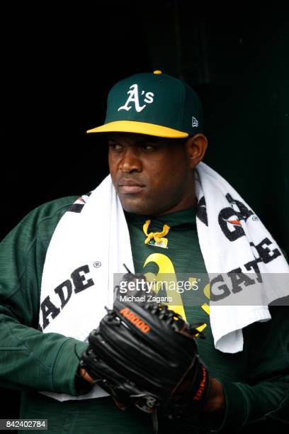 Santiago Casilla of the Oakland Athletics stands in the dugout during the game against the Seattle Mariners at the Oakland Alameda Coliseum on August...