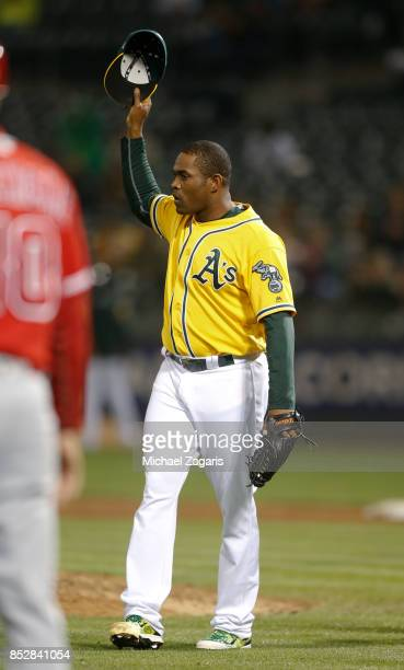 Santiago Casilla of the Oakland Athletics tips his cap after a great defensive play was made during the game against the Los Angeles Angels of...