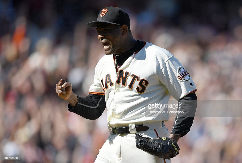 Santiago Casilla of the San Francisco Giants celebrates defeating the Washington Nationals 53 at ATT Park on July 30 2016 in San Francisco California...