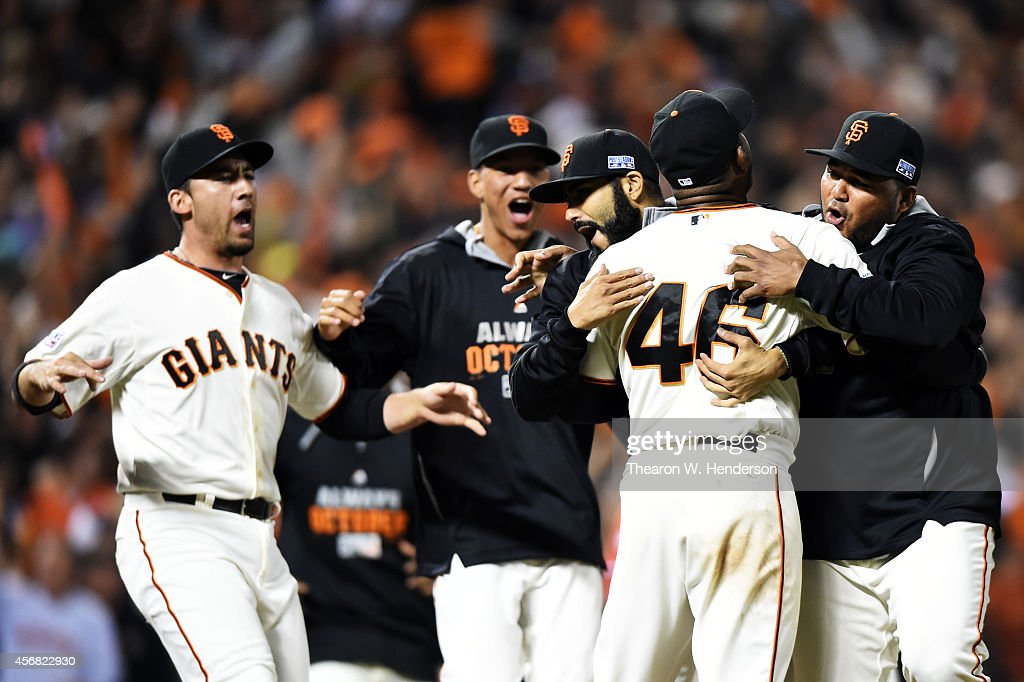 Santiago Casilla of the San Francisco Giants celebrates with teammates after the final out of their 3 to 2 win over the Washington Nationals during...