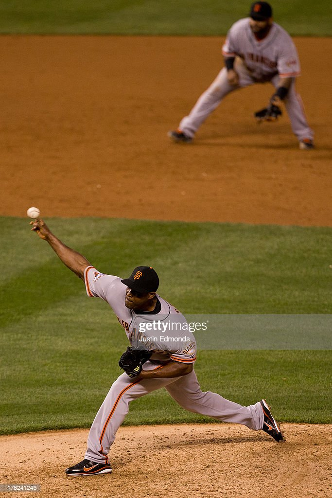 <a gi-track='captionPersonalityLinkClicked' href=/galleries/search?phrase=Santiago+Casilla&family=editorial&specificpeople=682637 ng-click='$event.stopPropagation()'>Santiago Casilla</a> #46 of the San Francisco Giants delivers to home plate during the eighth inning against the Colorado Rockies at Coors Field on August 27, 2013 in Denver, Colorado. The Giants defeated the Rockies 5-3.