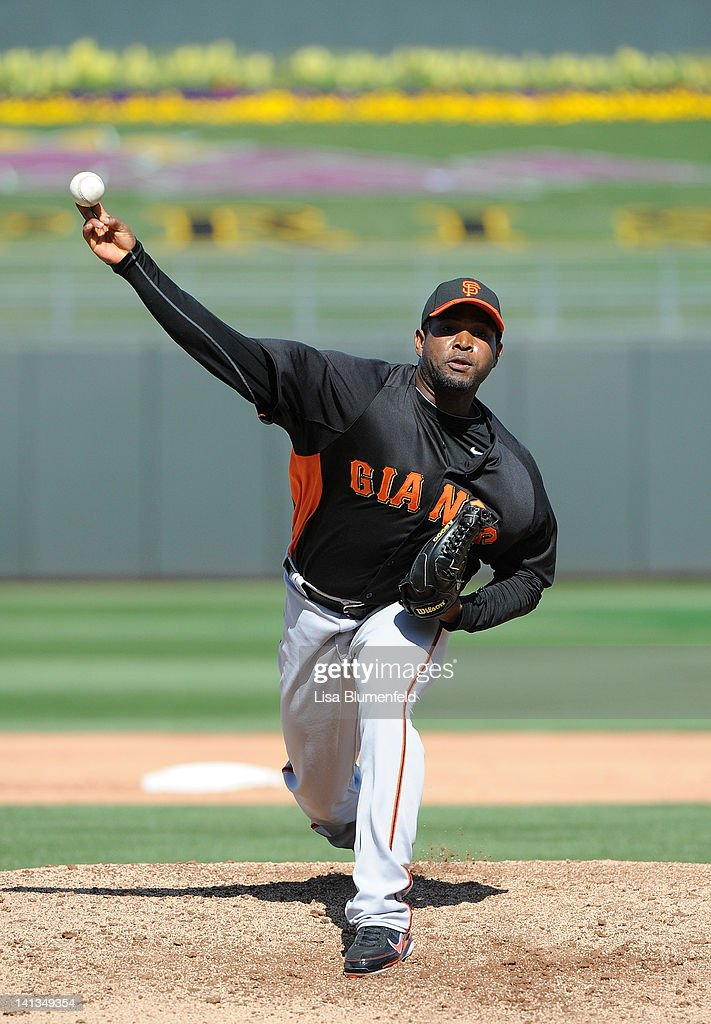 <a gi-track='captionPersonalityLinkClicked' href=/galleries/search?phrase=Santiago+Casilla&family=editorial&specificpeople=682637 ng-click='$event.stopPropagation()'>Santiago Casilla</a> #46 of the San Francisco Giants pitches against the Kansas City Royals on March 12, 2012 in Surprise, Arizona.