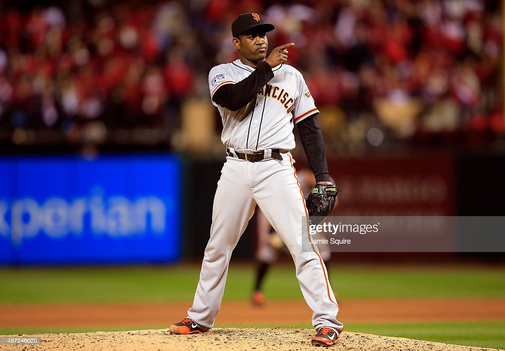 Santiago Casilla of the San Francisco Giants pitches against the St Louis Cardinals during Game One of the National League Championship Series at...