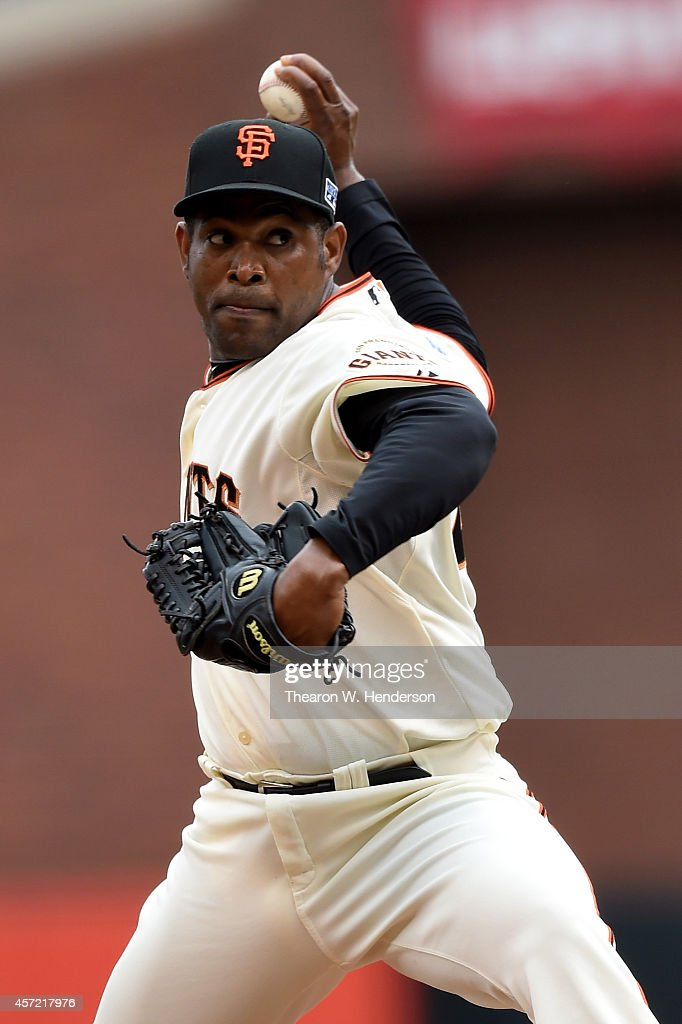 Santiago Casilla of the San Francisco Giants pitches in the ninth inning against the St Louis Cardinals during Game Three of the National League...