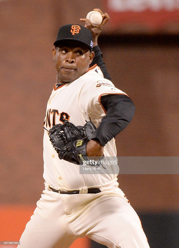 Santiago Casilla of the San Francisco Giants pitches in the ninth inning against the St Louis Cardinals during Game Four of the National League...