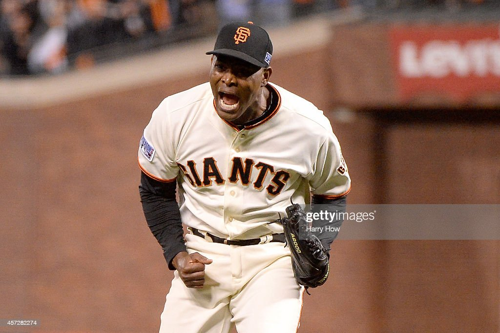 Santiago Casilla of the San Francisco Giants reacts after getting the final out in the ninth inning against the St Louis Cardinals during Game Four...