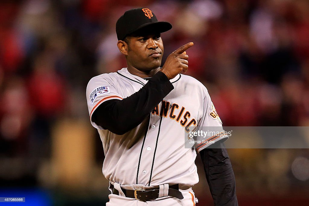 Santiago Casilla of the San Francisco Giants reacts in the ninth inning against the St Louis Cardinals during Game One of the National League...