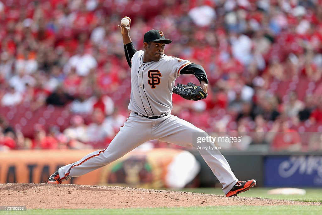 Santiago Casilla of the San Francisco Giants throws a pitch against the Cincinnati Reds at Great American Ball Park on May 17 2015 in Cincinnati Ohio
