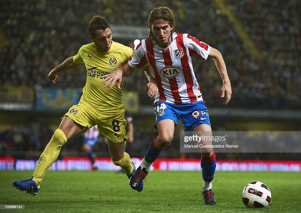 Santiago Cazorla (L) of Villarreal duels for the ball with Filipe Luis of Atletico de Madrid during the La Liga match between Villarreal and Atletico de Madrid at El Madrigal on October 24, 2010 in Villarreal, Spain.