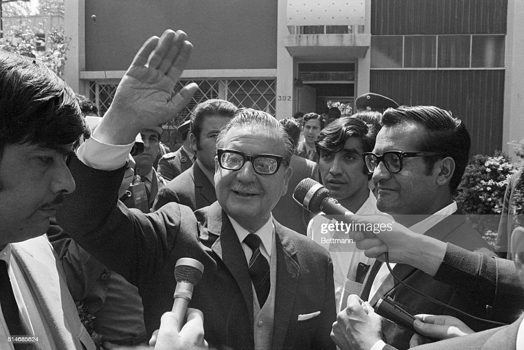 Chile's new president: Dr. <a gi-track='captionPersonalityLinkClicked' href=/galleries/search?phrase=Salvador+Allende&family=editorial&specificpeople=220786 ng-click='$event.stopPropagation()'>Salvador Allende</a> waves to well-wishers from the front garden of his suburban home here October 24th, after learning that the Chilean Congress had officially ratified him to become President. Allende, 62, is the first frelly chosen Marxist chief of state in the western hemisphere. SEE