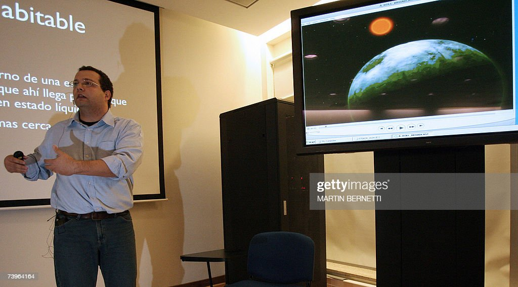 Portuguese astronomer Claudio Melo talks about the discovery by La Silla's observatory of a new planet 24 April 2007 at European Southern Observatory (ESO)'s facility in Santiago. Astronomers reported on Tuesday they had discovered a 'super-Earth' more than 20 light years away that is the most intriguing world found so far in the search for extraterrestrial life. About five times the mass of Earth, the planet orbits a cool, dim 'red dwarf' star located in the constellation of Libra, the team from the ESO said in a press release. The star, Gliese 581, has already been identified as hosting a planet similar in size to Neptune, the frigid gas giant on the edge of our own Solar System. The new planet is 14 times closer to Gliese 581 than the Earth is to the Sun. But because Gliese 581 is so cool, the planet is not scorched by solar radiation. It zips around the star at express speed, making just 13 days to complete an orbit.
