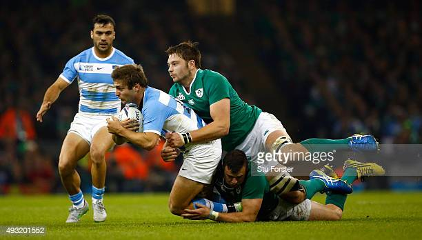 Santiago Cordero of Argentina breaks the tackle of Iain Henderson of Ireland during the 2015 Rugby World Cup Quarter Final match between Ireland and...